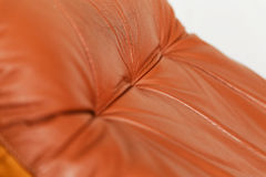 Closeup of red leather recliner chair. A closeup of a red leather recliner chair backrest Royalty Free Stock Images