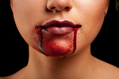 Closeup of Red lips of a young girl. With blood flowing by Stock Photos
