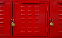 Closeup of red lockers doors.Abstract metall red colored texture. Closeup of red lockers doors and two brass padlocks. Abstract metall red colored texture Royalty Free Stock Image