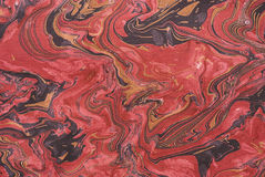Closeup of red marbleized paper royalty free stock image