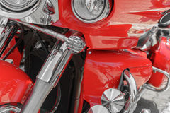 Closeup of red motorcycle. Beautiful modern red motorcycle headl Royalty Free Stock Photography
