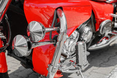 Closeup of red motorcycle. Beautiful modern red motorcycle headl Royalty Free Stock Images