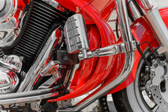 Closeup of red motorcycle. Beautiful modern red motorcycle headl Stock Photo