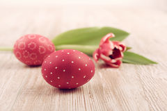 Closeup on red painted Easter Egg with tulip on wood Royalty Free Stock Photo