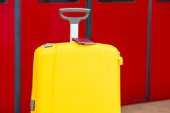 Closeup red passports on yellow luggage at train Royalty Free Stock Photo