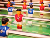 Closeup player of  football table game. Closeup red player of a football table game Stock Photos