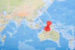 Closeup Red pushpin showing the location of destination point Royalty Free Stock Images