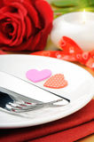 Closeup of red rose and cutlery Royalty Free Stock Photo
