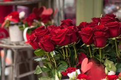 Red roses bouqet at the florist for the valentines day. Closeup of red roses bouqet at the florist for the valentines day royalty free stock photos