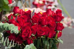 Red roses bouqet at the florist for the valentines day. Closeup of red roses bouqet at the florist for the valentines day stock images