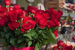 Red roses bouqet at the florist for the valentines day. Closeup of red roses bouqet at the florist for the valentines day royalty free stock image