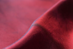 Closeup of red satin fabric. As background Stock Photo