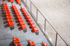 Closeup of red sport stadium seats. Empty stand. Team sport supporter Royalty Free Stock Photography