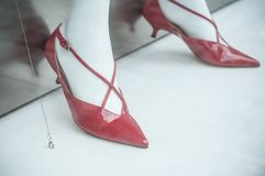 red stiletto shoes on mannequin in fashion store show Royalty Free Stock Photo