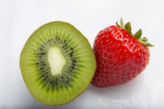 Closeup of strawberries and sliced kiwi fruits Royalty Free Stock Photo