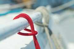 Closeup of red thin short line used for yachting purposes Stock Images
