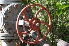 Closeup red valve. Closeup pipe and valve stock photos