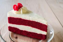 Closeup Red Velvet Cake with glass plate on strips red paper.
