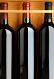 Closeup of Red Wine Bottles in Wooden Case Stock Photos