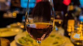 Closeup of red wine in glass. Bokeh stock images