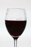 Closeup red wine glass with dewdrop Royalty Free Stock Image