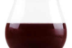 Closeup red wine glass isolated. Red wine glass over a white background Stock Images