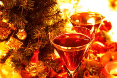 Closeup of red wine in glasses. Candle lights,baubles and green twig Royalty Free Stock Photography