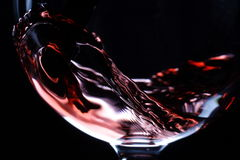 Closeup of red wine pouring stock images