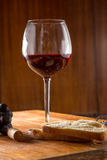 Closeup of red wine pouring in glass Royalty Free Stock Images