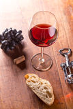 Closeup of red wine pouring in glass Stock Images