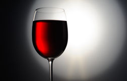 Closeup of red wine wineglass. On dark background Royalty Free Stock Photography
