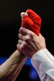 Closeup of referee raises hand of boxer winner Royalty Free Stock Photography