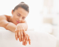 Closeup on relaxed young woman laying on massage table Stock Photos