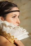 Closeup of a renaissance woman. Fine art renaissance portrait of a woman wearing a hair snood in the style of the old masters stock images