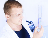 Closeup of a researcher man holding up a test tube Royalty Free Stock Photo