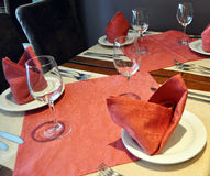Table setting. A table set for four in a restaurant Stock Photos