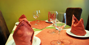 Table setting. Detailed view of a table set for four people Royalty Free Stock Image
