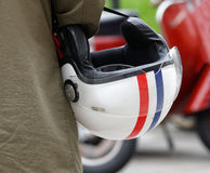Closeup of a retro helmet carried by a man Royalty Free Stock Image