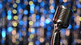 Closeup of retro microphone with blurred lights at background stock video