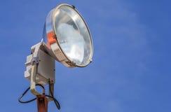 Closeup retro style sport light with blue sky background. Stock Photos