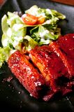Closeup of ribs with salad Stock Photos