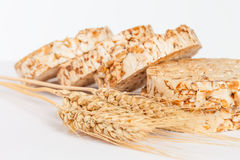 Closeup of rice cakes and wheat on white Royalty Free Stock Photos