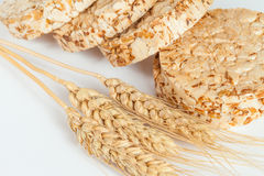 Closeup of rice cakes and wheat on white Royalty Free Stock Photo