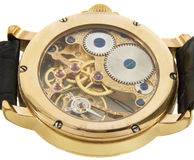 Closeup of rich gold swiss made chronograph watch. In white background. Back size Stock Image