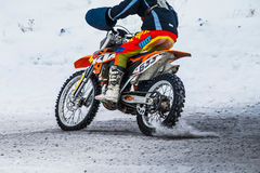 Closeup rider man motorcycle on snowy motocross track Stock Image