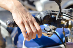 Closeup on rider's hand on the handlebar Stock Images