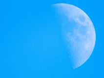Closeup of right half moon in the silent sky Royalty Free Stock Photo