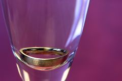 Closeup of a ring in a glass, isolated. Stock Images