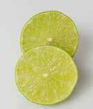 Closeup of a ripe lime fruit cut in half isolated Royalty Free Stock Photos