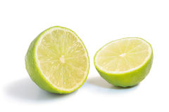 Closeup of a ripe lime fruit cut in half isolated Royalty Free Stock Images